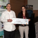 """The student prize at The 2014 Atlantic Biorefinery Conference was awarded to Luc Daigle of Collège communautaire du Nouveau-Brunswick for his poster: """"Extraction and quantification of hemicelluloses contained in lignocellulosic biomass."""" Presenting the award is Josée Landry, Manager of the Biorefinery Technology Scale-up Centre Sydney, Nova Scotia - June 6, 2014"""